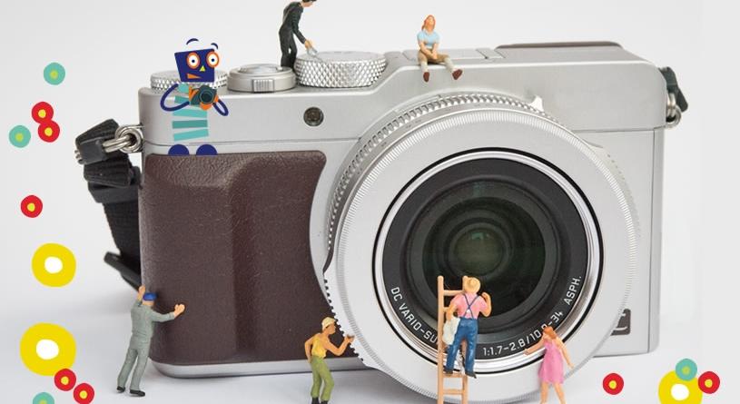 Miniaturfiguren bevölkern eine Kamera